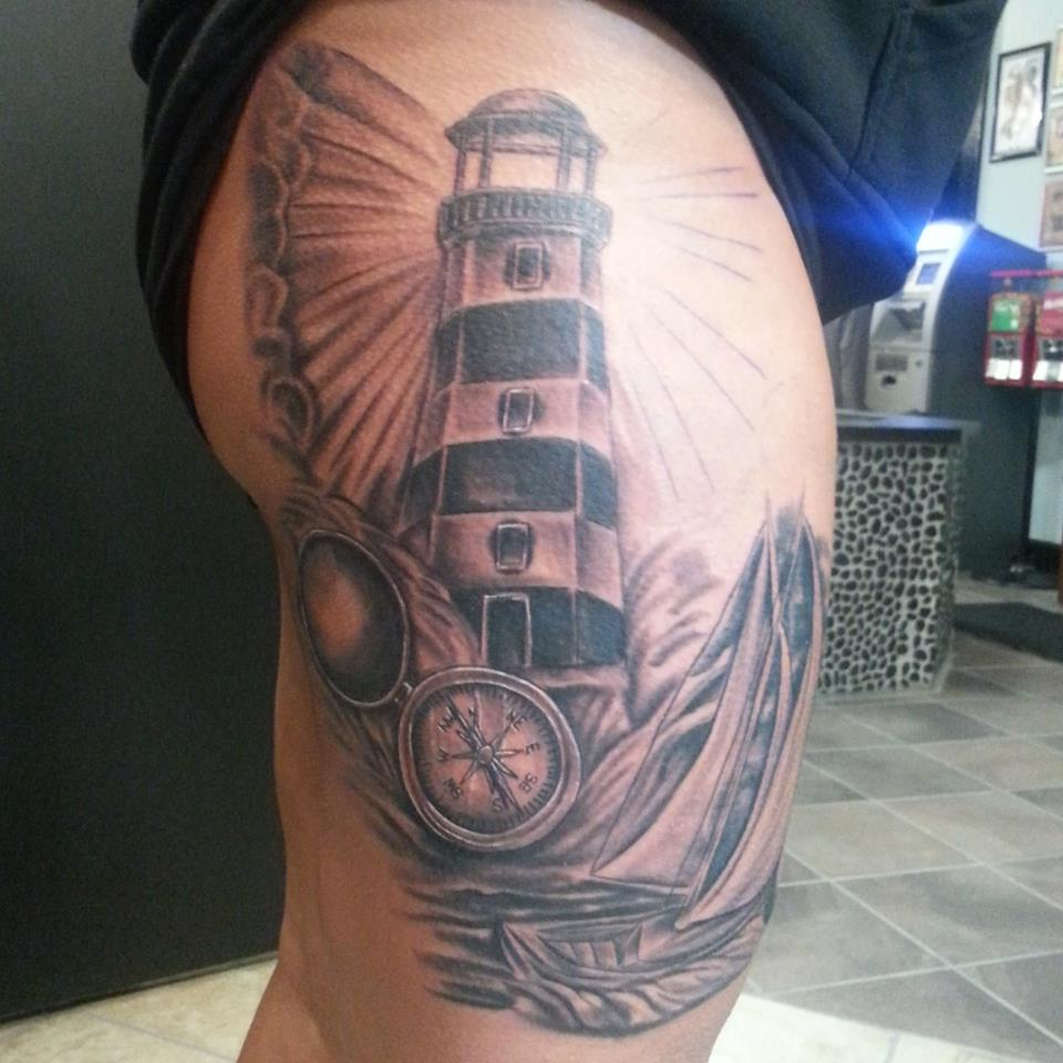Black and grey tattoo of a lighthouse