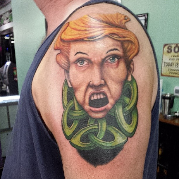Tattoo of a lady that looks angry