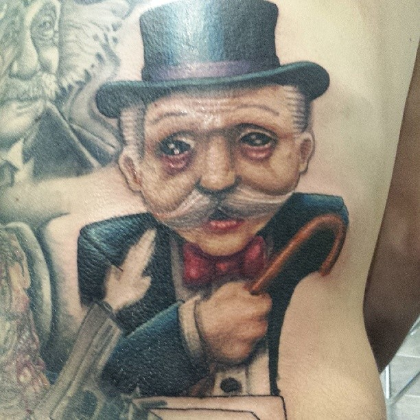 Tattoo of the monopoly man